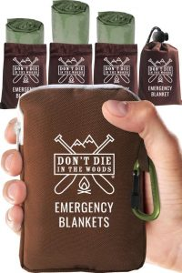Photo of a packed emergency blanket held in hand.